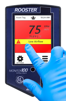 Grossing station airflow monitor has alarming capabilities and user-defined thresholds.