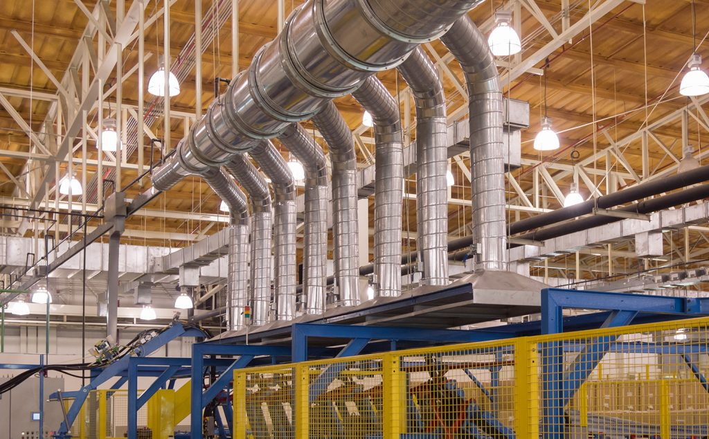 Local exhaust ventilation system performance monitored with airflow switches and monitors.